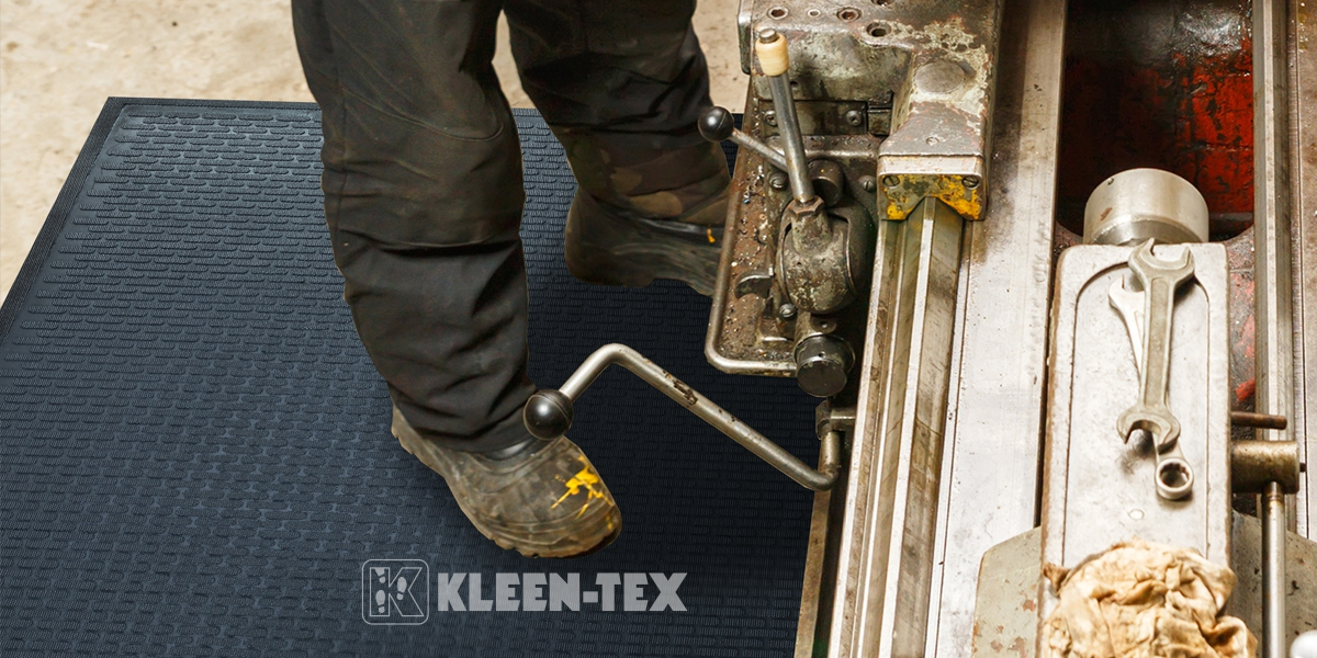 Kleen-Scrape in front of machine
